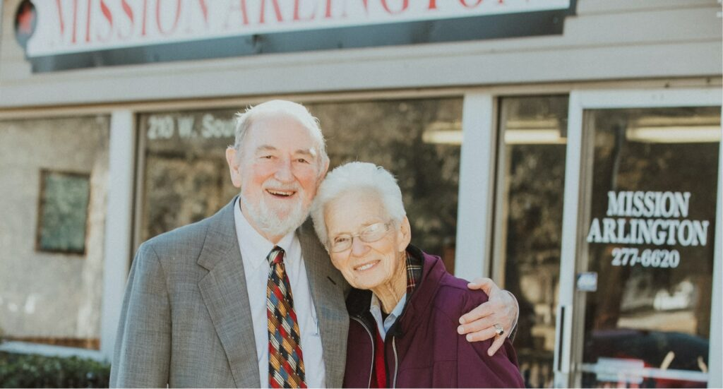 couple in front of storefront