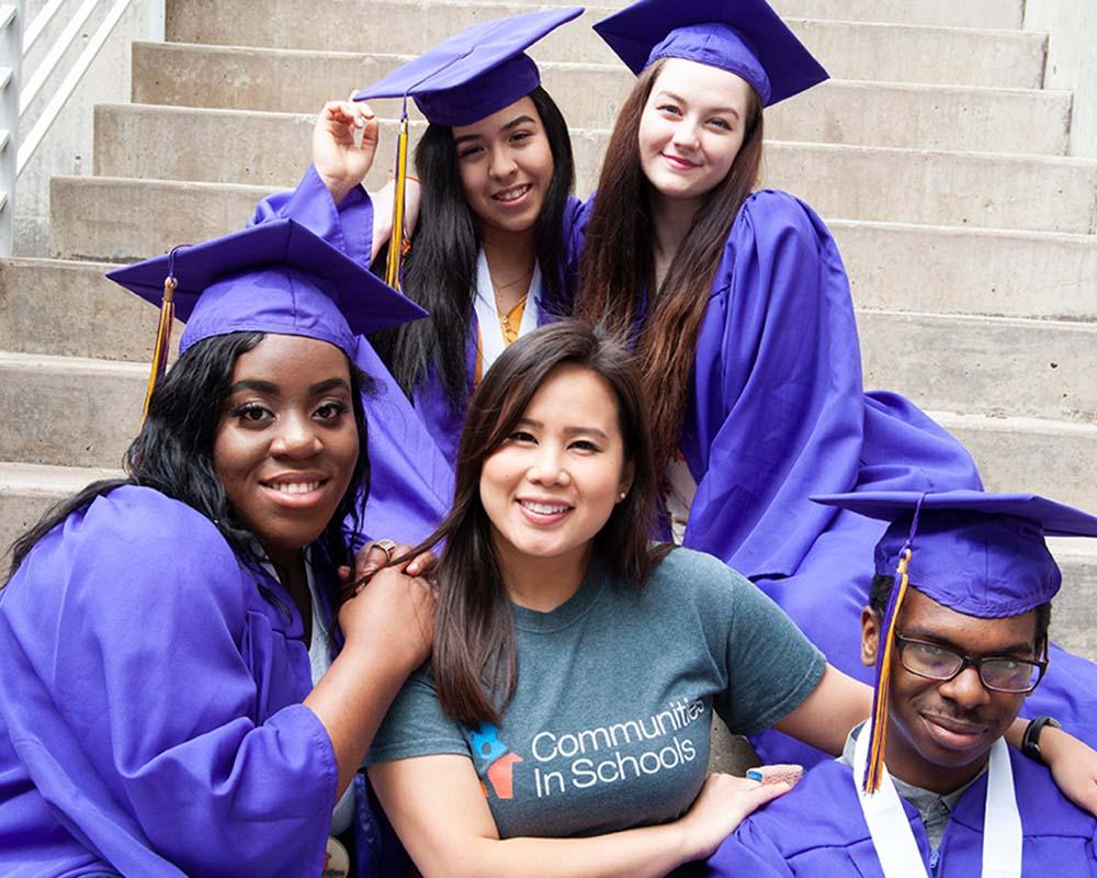 graduates together on steps